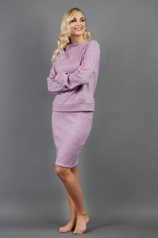 model is wearing diva catwalk elvira pencil pink skirt in soft cashmere fabric front paired with long sleeve top