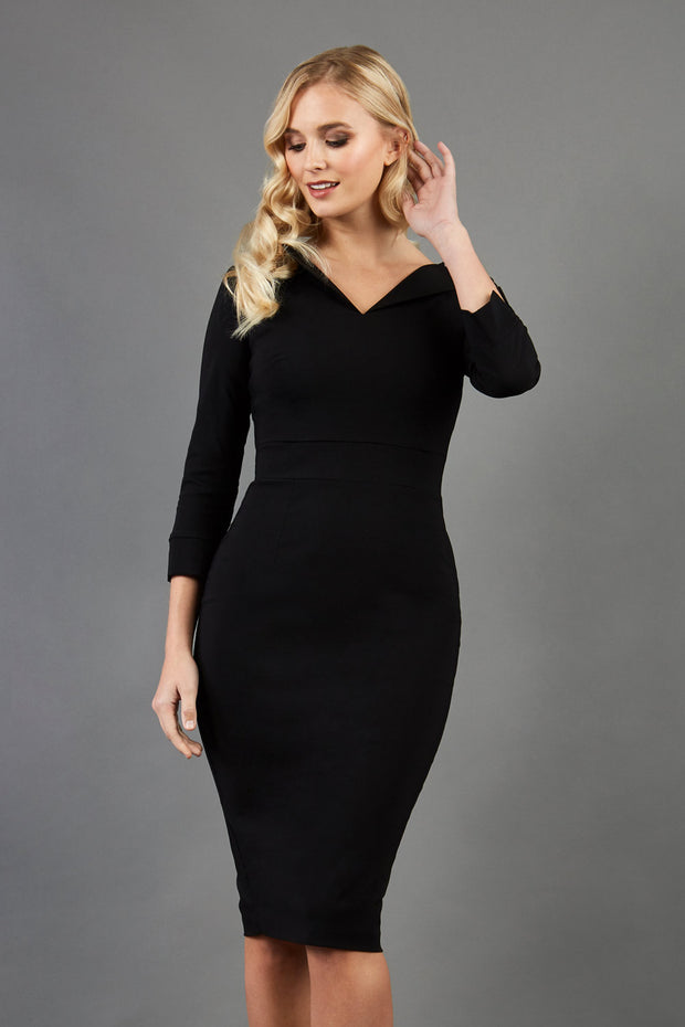 blonde model wearing damsel little black pencil dress with long sleeves and v neckline front