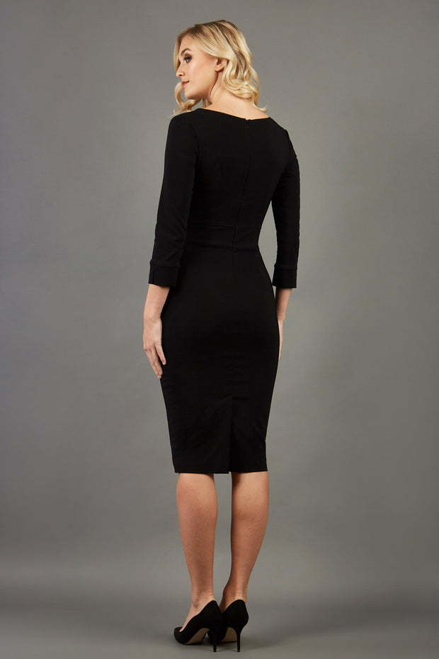 blonde model wearing damsel little black pencil dress with long sleeves and v neckline back