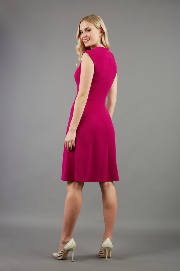 blonde model is wearing diva catwalk sleeveless swing skirt dress with asymmetric neckline in pink back