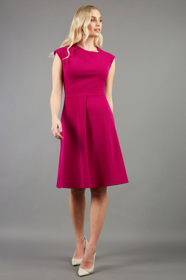 blonde model is wearing diva catwalk sleeveless swing skirt dress with asymmetric neckline in pink front