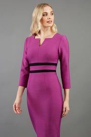 blonde model is wearing diva catwalk nandina pencil dress in dawn purple with contrasting doubled waistband with sleeves front