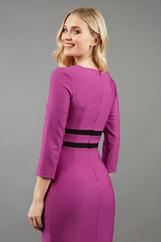 blonde model is wearing diva catwalk nandina pencil dress in dawn purple with contrasting doubled waistband with sleeves back