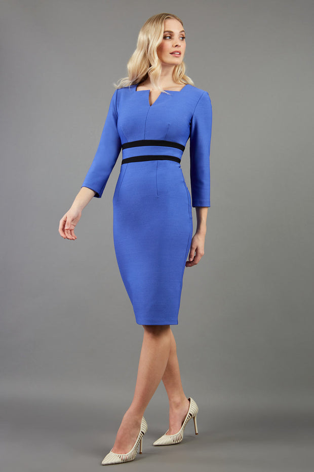 blonde model is wearing diva catwalk nandina pencil dress in blue with contrasting doubled waistband with sleeves front