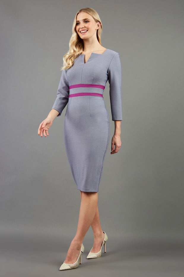 blonde model is wearing diva catwalk nandina pencil dress in slate grey with contrasting doubled waistband with sleeves front