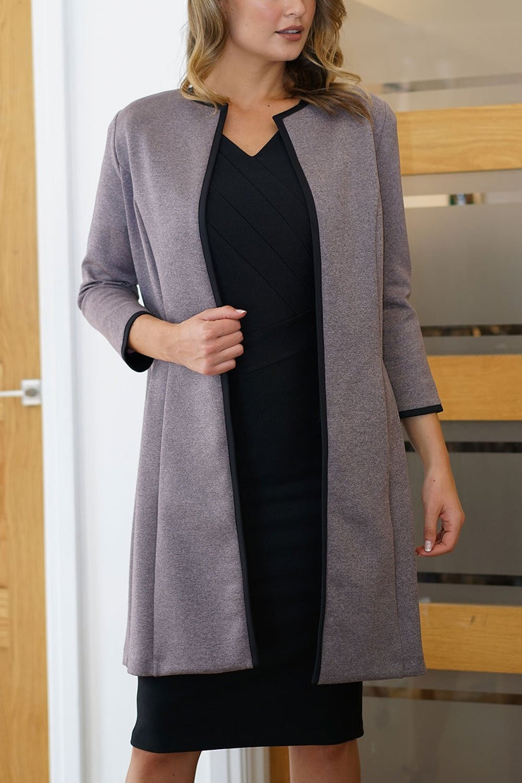 Model wearing the Diva Alverstone Coat in Mist Pink and black front image