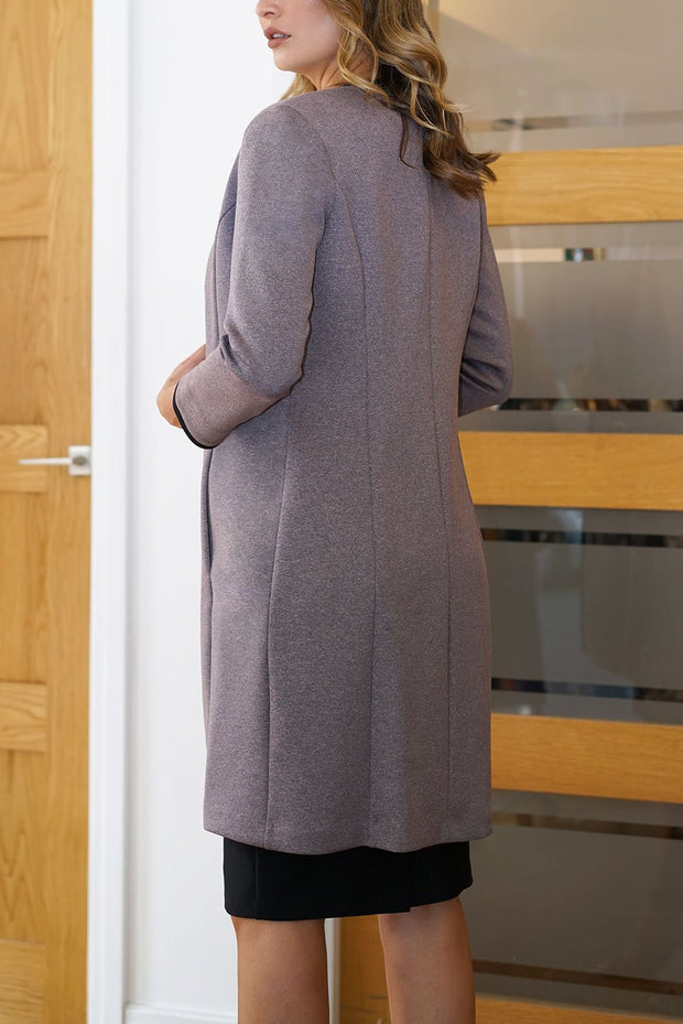 Model wearing the Diva Alverstone Coat in Mist Pink and black back image