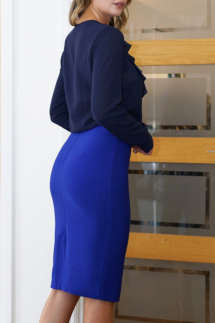 blonde model is wearing diva catwalk pencil skirt in royal blue paired with hambledon long sleeved top front