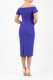 brunette model wearing diva catwalk juilet midaxi pencil sleeveless off shoulder dress with open neck and folded collar in colour spectrum indigo back