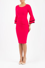 blonde model wearing diva catwalk tina pencil skirt dress with rounded neckline and flute sleeve in yarrow pink front