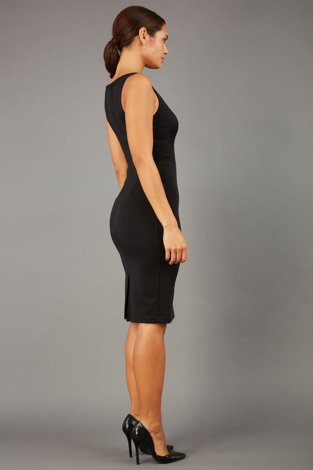 brunette model wearing diva catwalk plain pencil sleeveless dress in black colour back