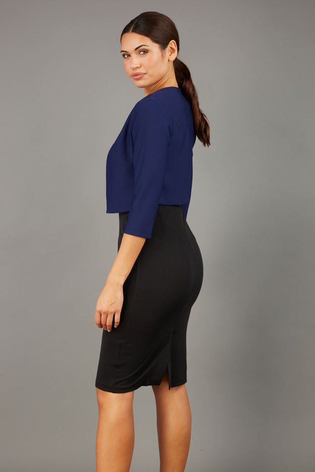 brunette model wearing diva catwalk navy sleeved bolero over a little black pencil dress front