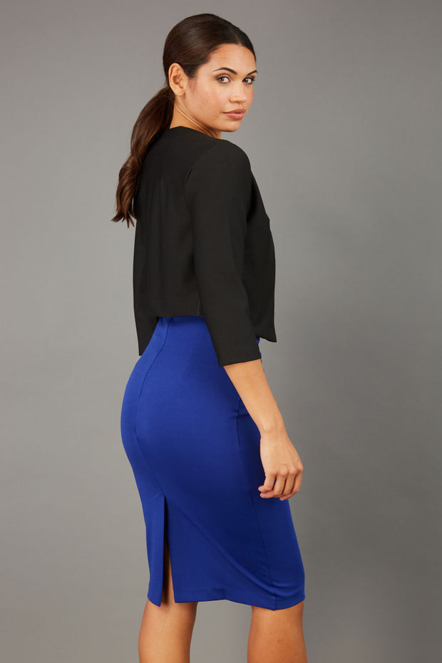 brunette model wearing diva catwalk black sleeved bolero over a royal blue pencil dress front