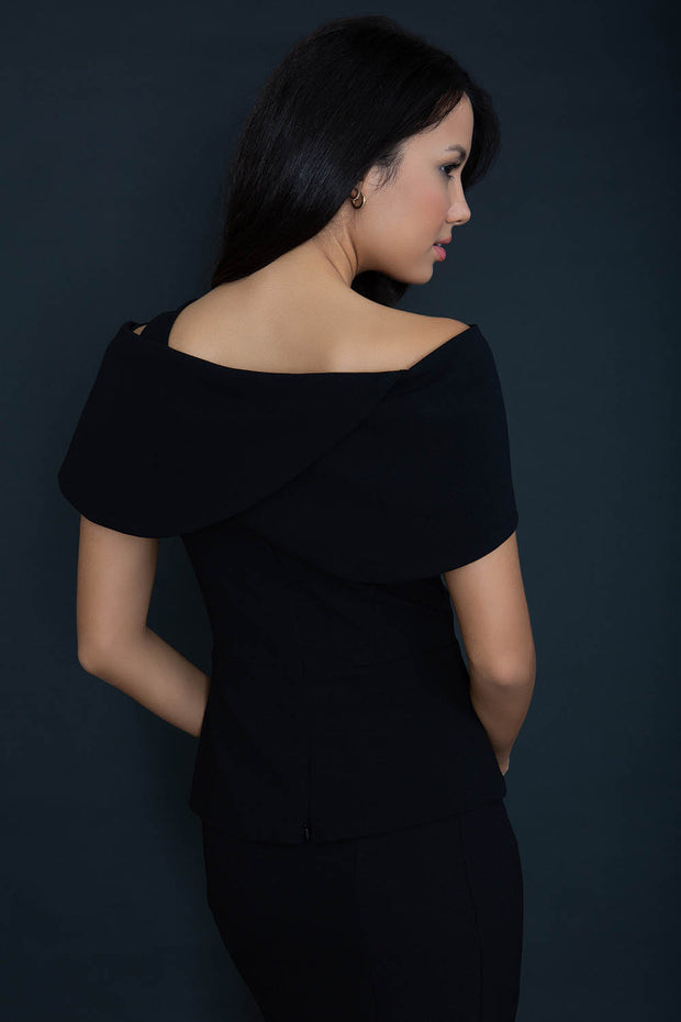 model wearing diva catwalk asymmetric neckline black short sleeve top back