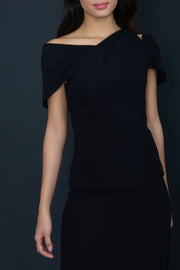 model wearing diva catwalk asymmetric neckline black short sleeve top
