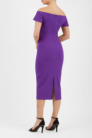 brunette model wearing diva catwalk juilet midaxi pencil sleeveless off shoulder dress with open neck and folded collar in colour passion purple back