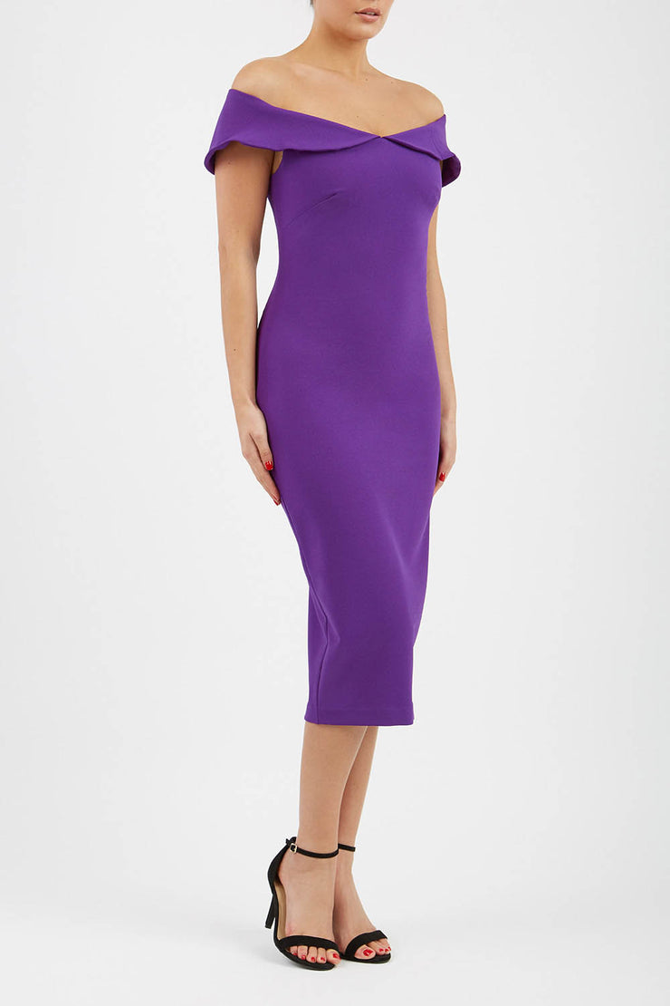 brunette model wearing diva catwalk juilet midaxi pencil sleeveless off shoulder dress with open neck and folded collar in colour passion purple front