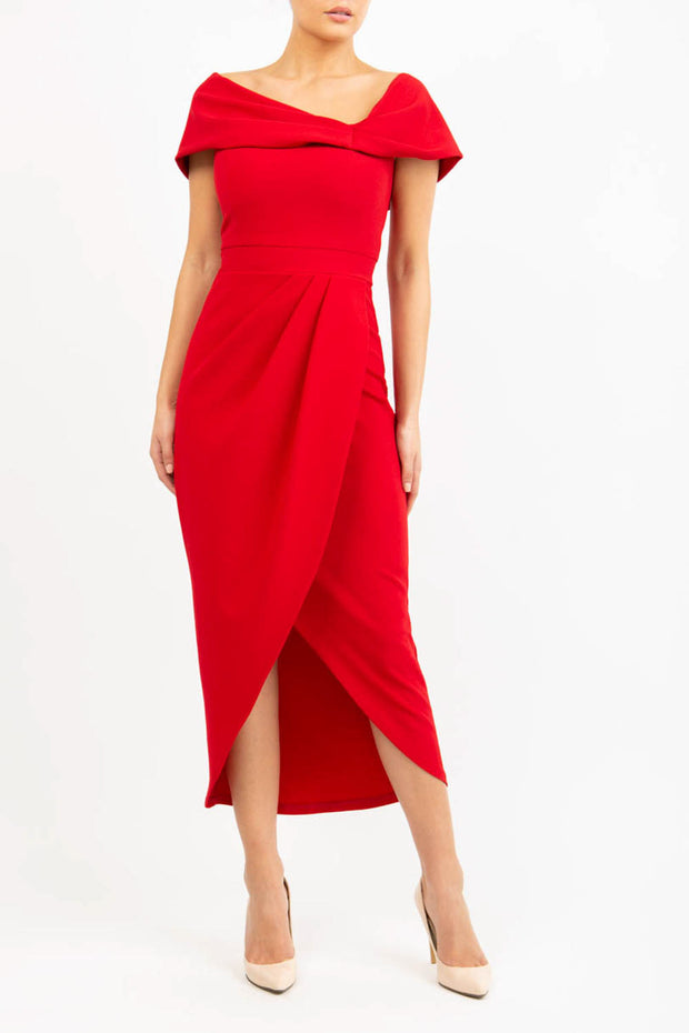 brunette model wearing diva catwalk vegas calf length scarlet red midaxi dress with wide bardot neckline and open shoulders with a large opening at the front of the skirt with pleating coming down long skirt front