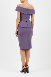 blonde model wearing diva catwalk peplum pencil skirt dress in mauve colour off shoulder bardot neckline back