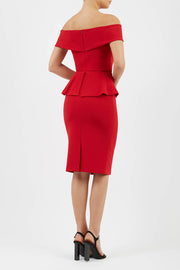 blonde model wearing diva catwalk peplum pencil skirt dress in scarlet red colour off shoulder bardot neckline back