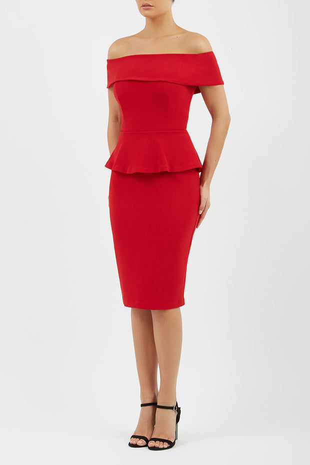 blonde model wearing diva catwalk peplum pencil skirt dress in scarlet red colour off shoulder bardot neckline front