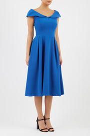 Model wearing the Diva Chesterton Sleeveless dress with oversized collar detail and swing pleated skirt in cobalt blue front image