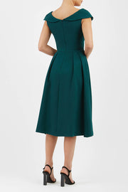 Model wearing the Diva Chesterton Sleeveless dress with oversized collar detail and swing pleated skirt in forest green back image