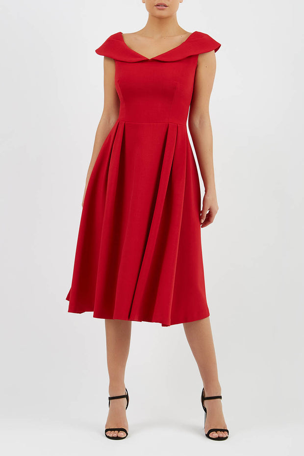 Model wearing the Diva Chesterton Sleeveless dress with oversized collar detail and swing pleated skirt in dark red front image