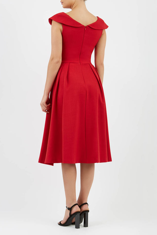 Model wearing the Diva Chesterton Sleeveless dress with oversized collar detail and swing pleated skirt in dark red back image
