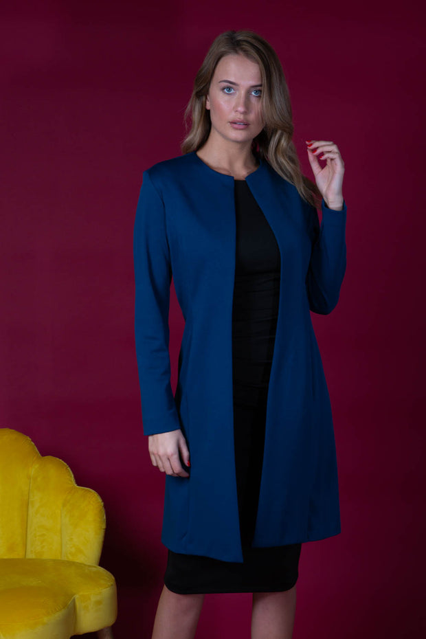 model wearing diva catwalk navy blue coat with long sleeves and a belt front