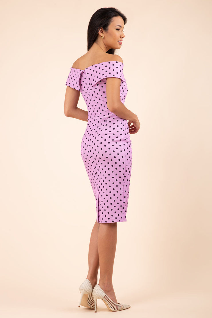 Brunette model wearing Diva Catwalk Fenella Polka Dot Pencil Sleeveless Dress off shoulder bardot neckline in pink back