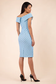 Brunette model wearing Diva Catwalk Fenella Polka Dot Pencil Sleeveless Dress off shoulder bardot neckline in blue back