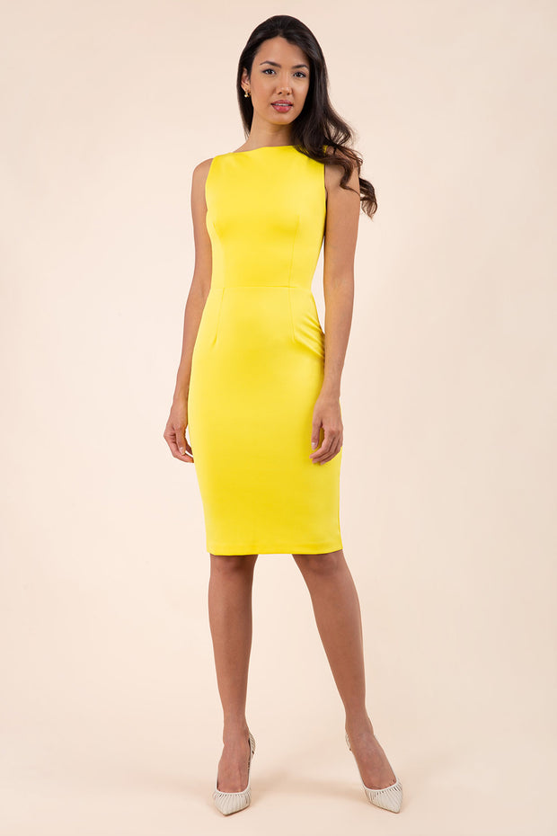 blonde model wearing diva catwalk plain pencil sleeveless dress in blazing yellow front