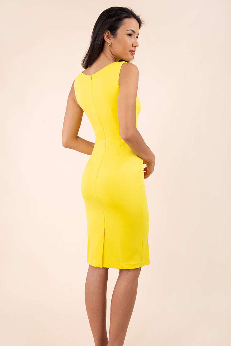 blonde model wearing diva catwalk plain pencil sleeveless dress in blazing yellow back