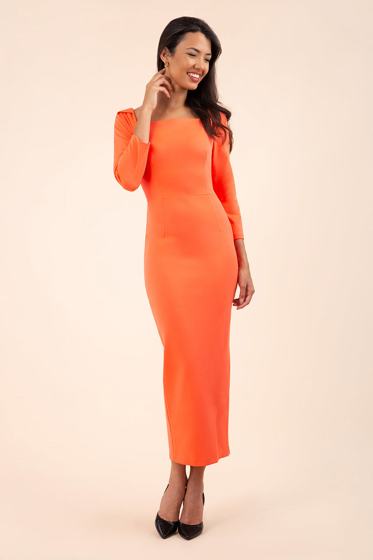 brunette model wearing diva catwalk maxi plain three quarter sleeve dress with pleating on shoulders and square neckline in hot coral front