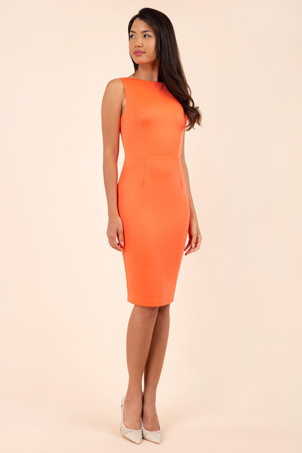blonde model wearing diva catwalk plain pencil sleeveless dress in hot coral  front