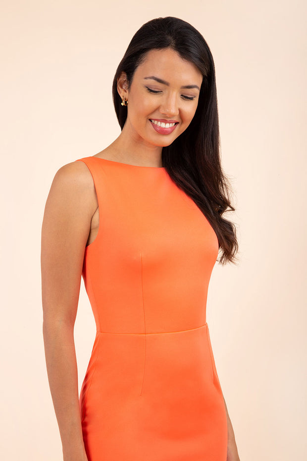 brunette model wearing diva catwalk plain pencil sleeveless dress in hot coral front
