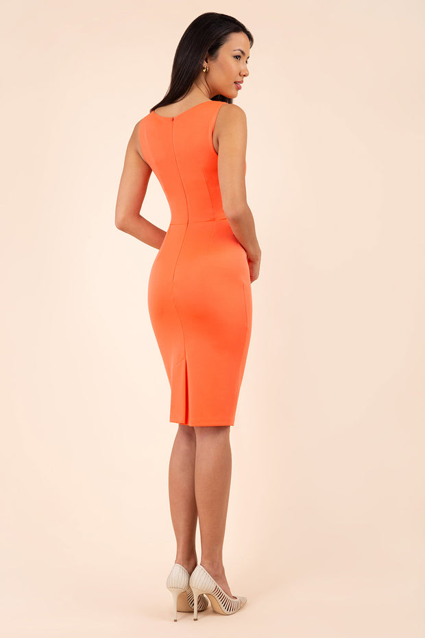 blonde model wearing diva catwalk plain pencil sleeveless dress in hot coral back