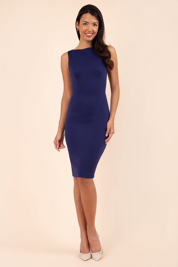 blonde model wearing diva catwalk plain pencil sleeveless dress in navy blue front