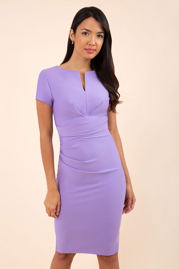 model wearing diva catwalk donna pencil dress in colour lilac with wide band and sleeves and rounded neckline with low split in front
