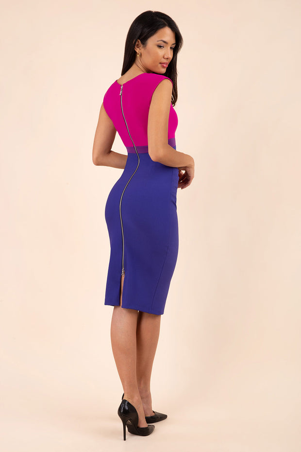 Brunette Model wearing sleeveless colour block Nadia dress with exposed zip at the back