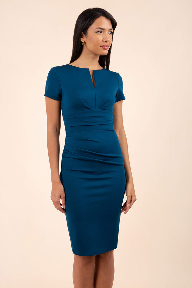 model wearing diva catwalk donna pencil dress in colour glorious teal with wide band and sleeves and rounded neckline with low split in front