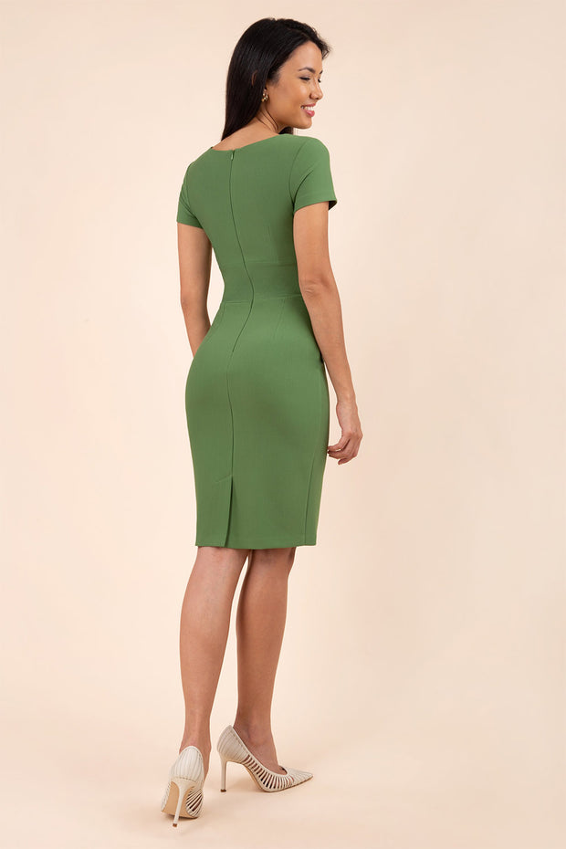model wearing diva catwalk donna pencil dress in colour green with wide band and sleeves and rounded neckline with low split in front back