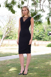 blonde model wearing diva catwalk pastiche pencil fitted sleeveless dress v-neckline with lace overlay in black front