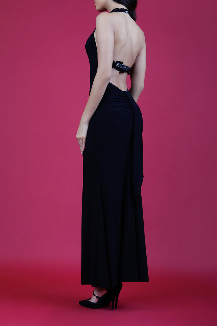 Model wearing Afterdark Full Length Sleeveless Open U-shape Back and Cowl neckline Dress with and Sequined straps over neckline and back in Black back