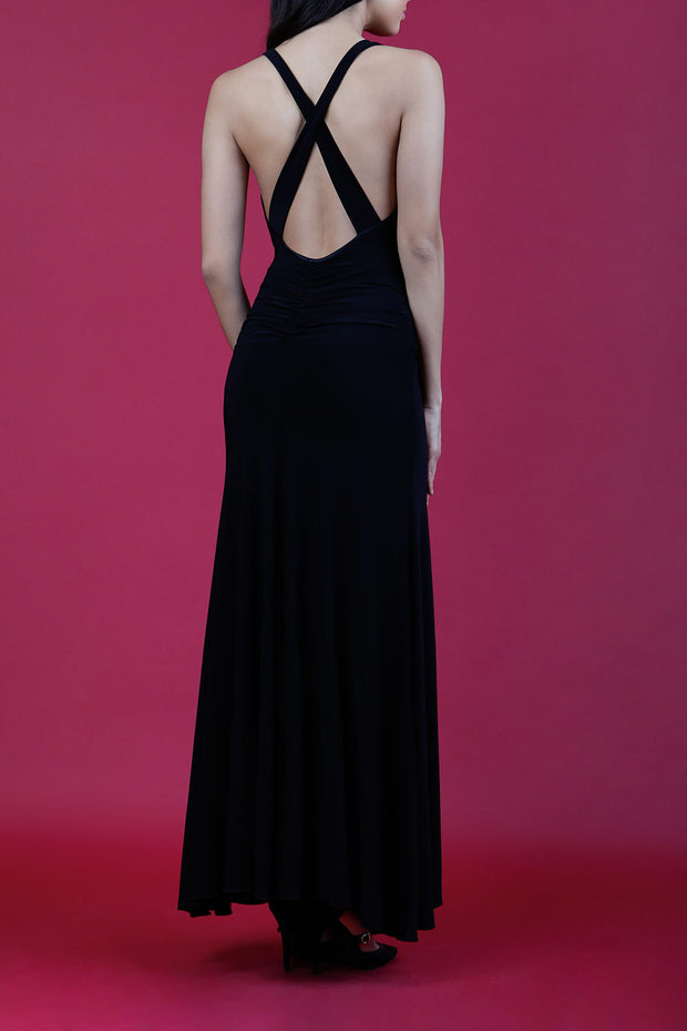 Model wearing Daring Full Length Sleeveless Open U-shape x-cross detailed Back  and Cowl neckline Dress in Black back