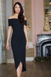 brunette model wearing diva catwalk vegas calf length black midaxi dress with wide bardot neckline and open shoulders with a large opening at the front of the skirt with pleating coming down long skirt front  Edit alt text