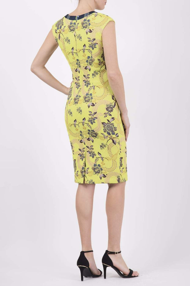 Model wearing the Diva Adeline Shift dress with V-neckline with a trim in Citronelle Green back image
