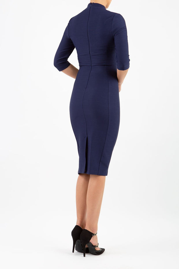 Model wearing the Seed Amalfi in pencil dress design in navy blue back image
