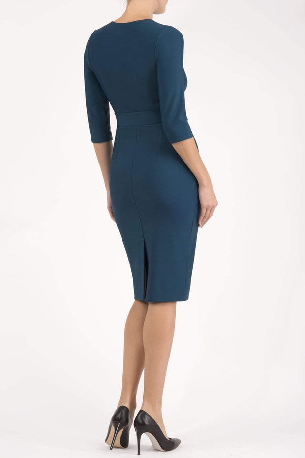 Model wearing the Diva Amatis Pencil dress with round neckline, inserted tie detailing at the front in glorious teal back image